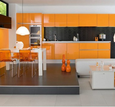 Modular Kitchen with orange shades for a stylish look