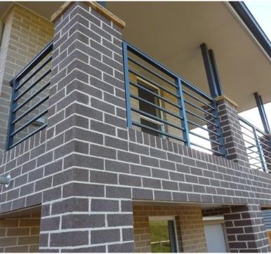 Dark brick wall cladding design