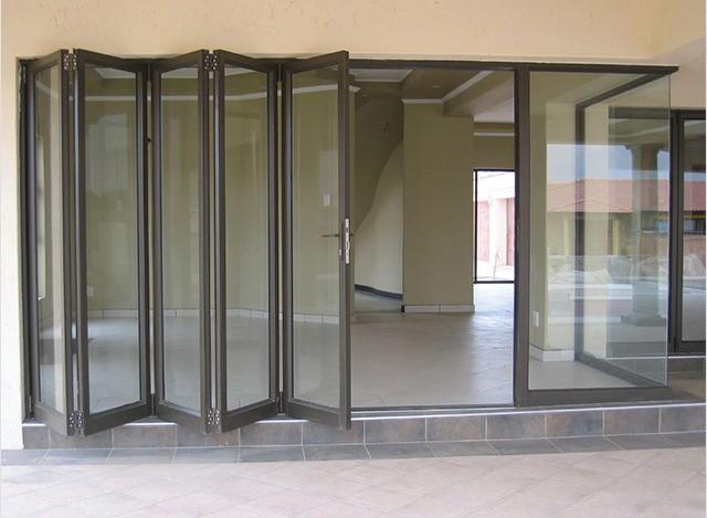 Aluminium Slide & Fold Doors by Sri Sai Enterprises